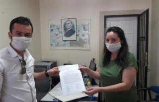MHP İlçe Başkanı Güldürüm, mazbatasını aldı