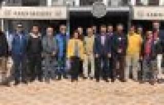 Marmaris'teki gazetecilere MGC rozeti takıldı
